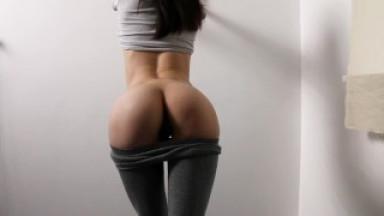 Fitness girl in leggings masturbating near the wall.