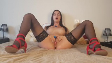 Masturbation with wide legs in stockings and high heels