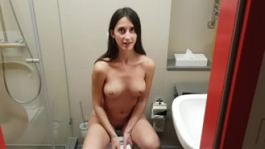 Girl pisses in the toilet and a man comes to her
