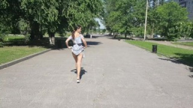 The girl lifts her skirt in the street