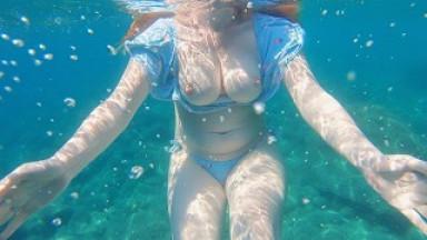 Redhead Swim in Playful Swimsuit Flashing her Big Tits on Busy Public Beach
